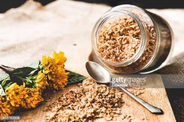 Buckwheat flakes in glass jar