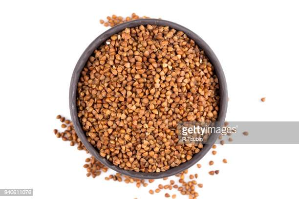 buckwheat groats in a bowl - buckwheat stock pictures, royalty-free photos & images