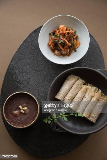 Buckwheat wrap, Patjuk (Red Bean Porridge), Spicy sea-snails salad