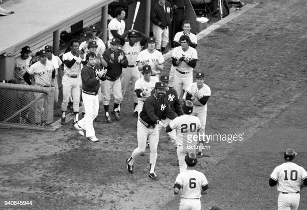 Bucky Dent #20 is greeted by his teammates after hitting a three run home run in the 7th inning at Fenway Park giving the Yankees a 42 lead
