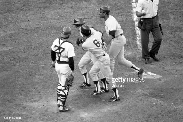 Bucky Dent, number 20, is greeted by his teammates after hitting a three run home run in the 7th inning at Fenway Park giving the Yankees a 4-1 lead.
