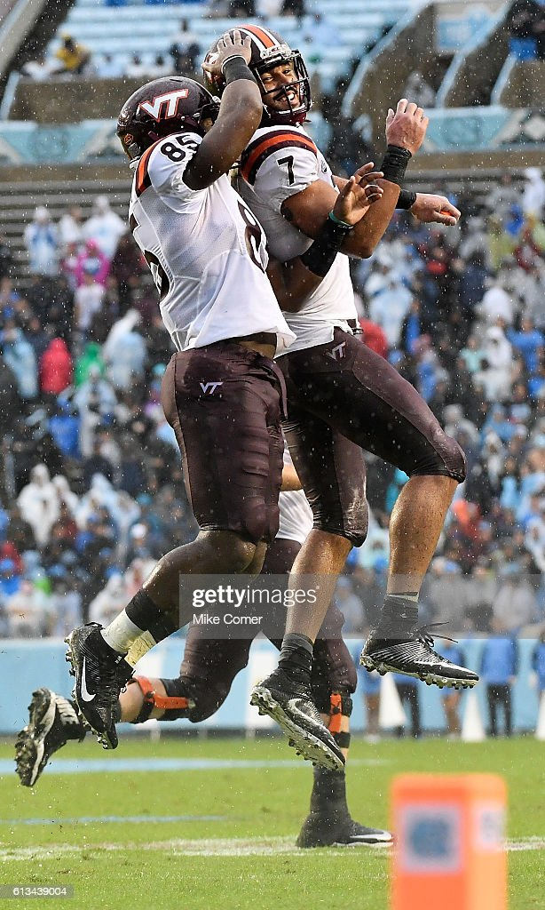 Bucky Hodges #7 and Chris Cunningham #85 of the Virginia Tech Hokies celebrate Cunningham's touchdown against the UNC Tar Heels at Kenan Stadium on October 8, 2016 in Chapel Hill, North Carolina.