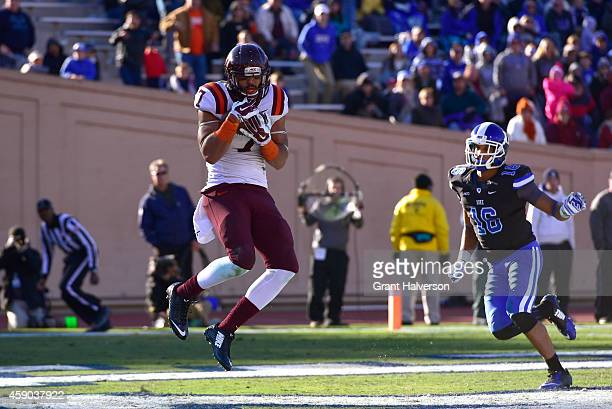 Bucky Hodges of the Virginia Tech Hokies catches the gamewinning touchdown against Jeremy Cash of the Duke Blue Devils during fourth quarter of their...