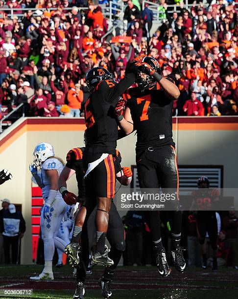 Bucky Hodges of the Virginia Tech Hokies celebrates with Cam Phillips after making a catch for a touchdown against the North Carolina Tar Heels on...