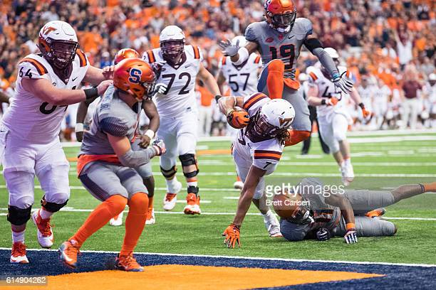 Bucky Hodges of the Virginia Tech Hokies dives into the end zone for a touchdown that would tie the game during the fourth quarter against the...