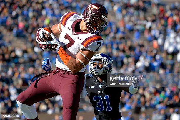 Bucky Hodges of the Virginia Tech Hokies makes a catch against Breon Borders of the Duke Blue Devils during their game at Wallace Wade Stadium...