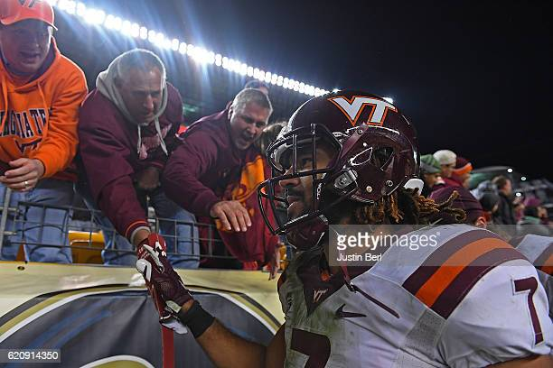 Bucky Hodges of the Virginia Tech Hokies shakes hands with fans after the conclusion of the Virginia Tech Hokies 3936 win over the Pittsburgh...