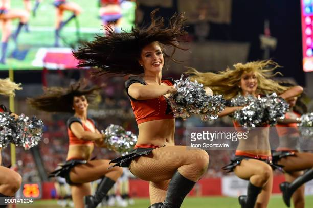 Bucs cheerleaders perform during the second half of an NFL game between the New Orleans Saints and the Tampa Bay Buccaneers on December 31 at Raymond...