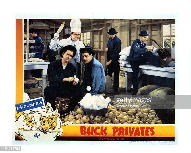 Bud Abbott and Lou Costello peel potatoes in movie art from the film 'Buck Privates' 1941