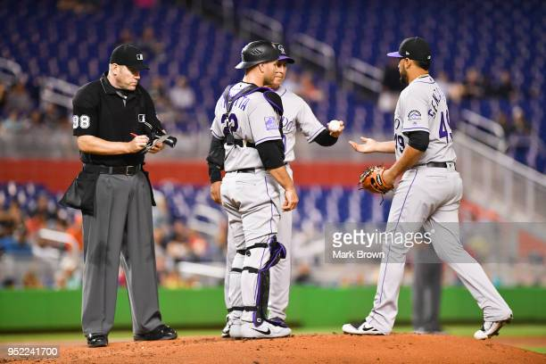 Bud Black of the Colorado Rockies hands the ball to Antonio Senzatela of the Colorado Rockies as he takes over for injured Tyler Anderson in the...