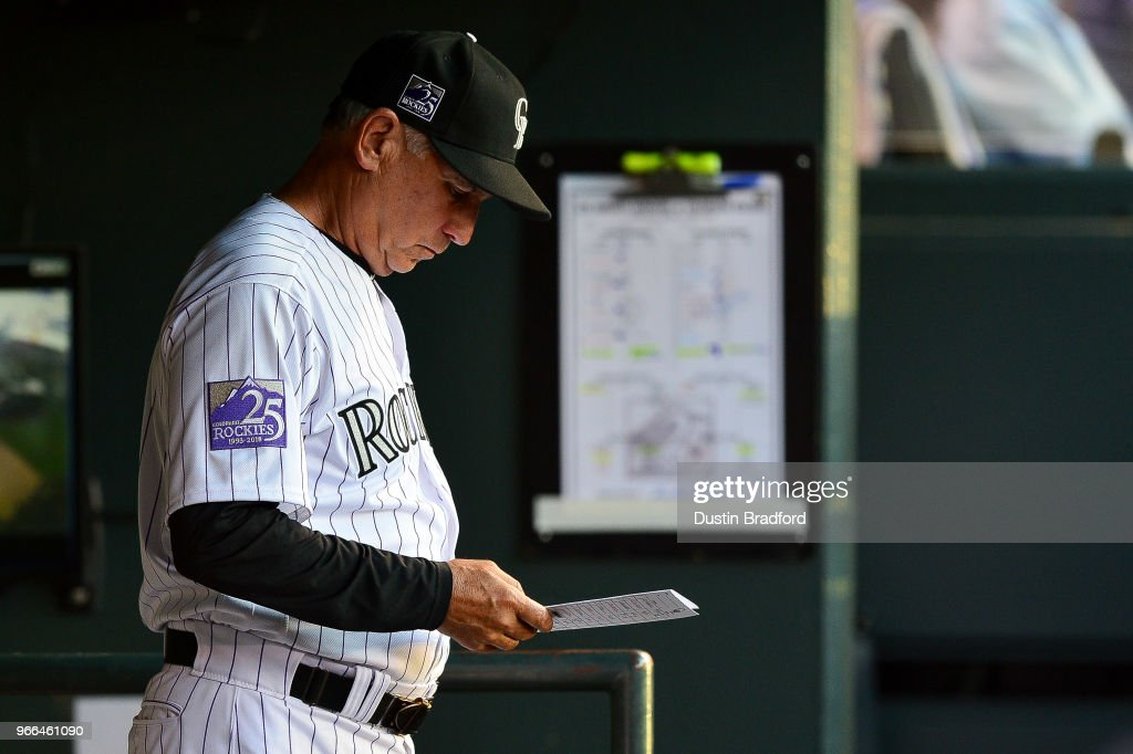Bud Black #10 of the Colorado Rockies looks over the lineup card during an 8-run inning by the Los Angeles Dodgers during a game at Coors Field on June 2, 2018 in Denver, Colorado.