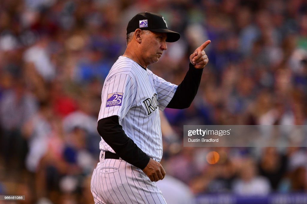 Bud Black #10 of the Colorado Rockies signals for a pitching change in an 8-run seventh inning of a game against the Los Angeles Dodgers at Coors Field on June 2, 2018 in Denver, Colorado.