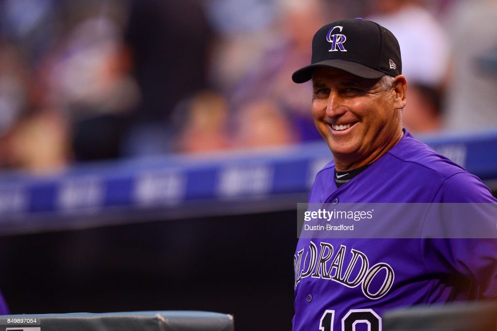 Bud Black #10 of the Colorado Rockies smiles and looks on from the dugout during a game against the San Diego Padres at Coors Field on September 15, 2017 in Denver, Colorado.