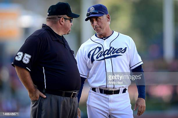 Bud Black of the San Diego Padres discusses a call with umpire Wall Bell at third base against the Texas Rangers during an interleague game at Petco...