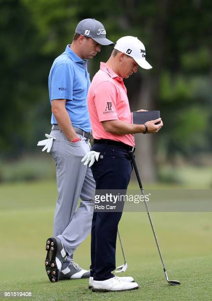 Bud Cauley and Daniel Berger wait to play their shot on the 15th hole during the first round of the Zurich Classic at TPC Louisiana on April 26 2018...