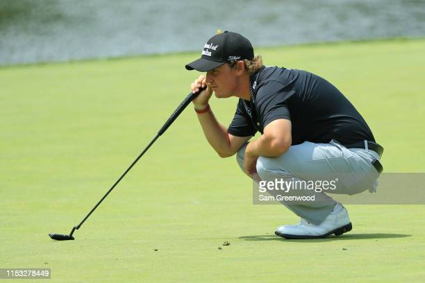 Bud Cauley lines up a putt on the third hole during the final round of The Memorial Tournament Presented by Nationwide at Muirfield Village Golf Club...