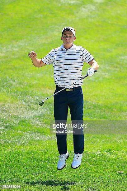 Bud Cauley of the United States reacts to his shot on the 18th hole during the first round of the travelers Championship at TPC River Highlands on...