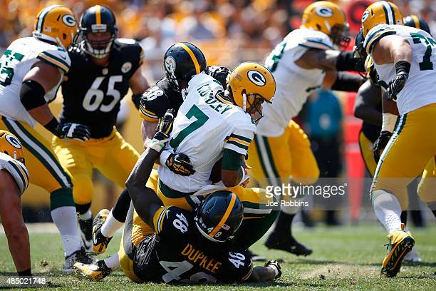 Bud Dupree and Ian Wild of the Pittsburgh Steelers sack Brett Hundley of the Green Bay Packers in the second half of a preseason game at Heinz Field...