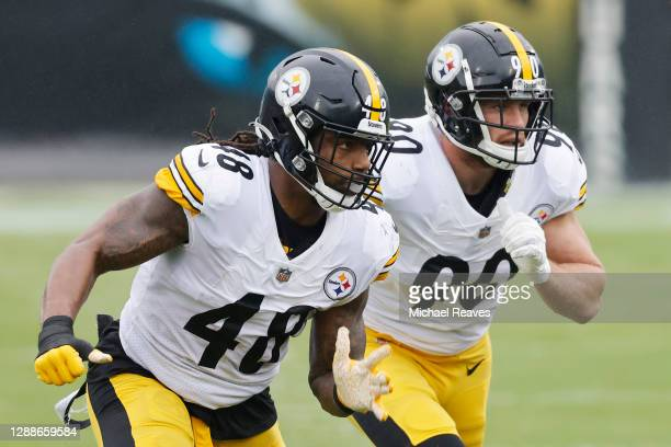 Bud Dupree and T.J. Watt of the Pittsburgh Steelers in action against the Jacksonville Jaguars at TIAA Bank Field on November 22, 2020 in...