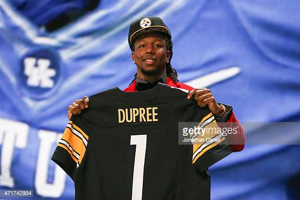 Bud Dupree of the Kentucky Wildcats holds up a jersey after being picked overall by the Pittsburgh Steelers during the first round of the 2015 NFL...