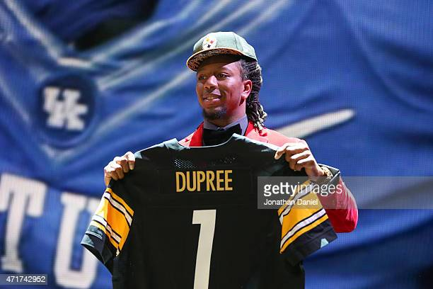 0b1aed75118 Bud Dupree of the Kentucky Wildcats holds up a jersey after being picked  overall by the