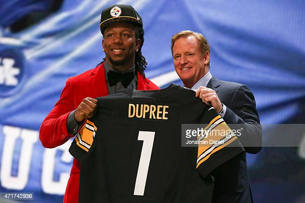 Bud Dupree of the Kentucky Wildcats holds up a jersey with NFL Commissioner Roger Goodell after being picked overall by the Pittsburgh Steelers...