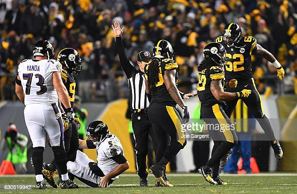 Bud Dupree of the Pittsburgh Steelers celebrates with Johnny Maxey after sacking Joe Flacco of the Baltimore Ravens in the first half during the game...
