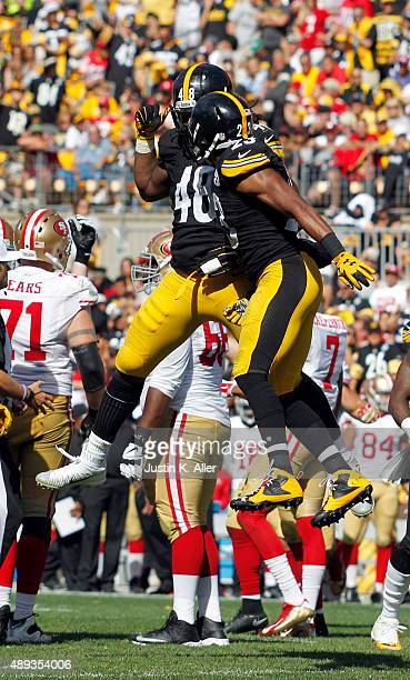 Bud Dupree of the Pittsburgh Steelers celebrates with Mike Mitchell of the Pittsburgh Steelers after a sack in the second half during the game...