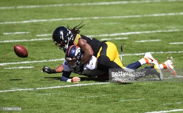Bud Dupree of the Pittsburgh Steelers forces a fumble after hitting Drew Lock of the Denver Broncos during the first quarter at Heinz Field on...
