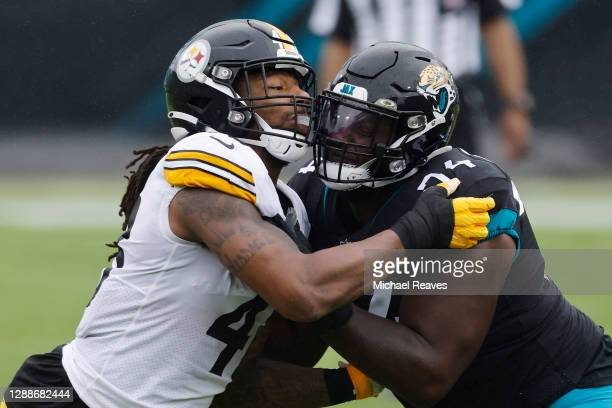Bud Dupree of the Pittsburgh Steelers in action against Cam Robinson of the Jacksonville Jaguars at TIAA Bank Field on November 22, 2020 in...