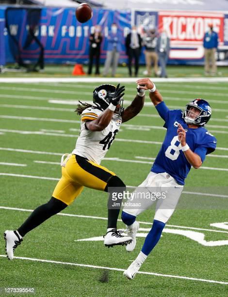 Bud Dupree of the Pittsburgh Steelers in action against Daniel Jones of the New York Giants at MetLife Stadium on September 14, 2020 in East...