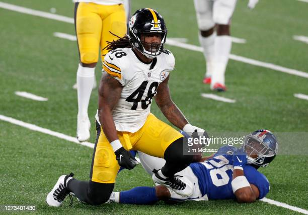 Bud Dupree of the Pittsburgh Steelers in action against Saquon Barkley of the New York Giants at MetLife Stadium on September 14, 2020 in East...