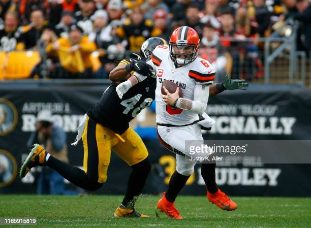 Bud Dupree of the Pittsburgh Steelers strip sacks Baker Mayfield of the Cleveland Browns in the second half on December 1, 2019 at Heinz Field in...