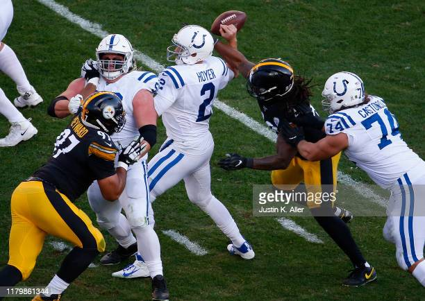Bud Dupree of the Pittsburgh Steelers strip sacks Brian Hoyer of the Indianapolis Colts in the second half on November 3, 2019 at Heinz Field in...