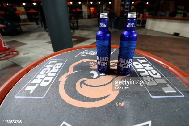 Bud Light beer cans sit on a table in right field during the Baltimore Orioles and Toronto Blue Jays game at Oriole Park at Camden Yards on September...