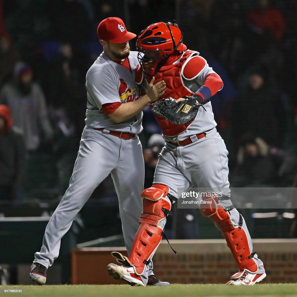 Bud Norris #26 (L) and Yadier Molina #4 of the St. Louis Cardinals celebrate a victory over the Chicago Cubs at Wrigley Field on April 17, 2018 in Chicago, Illinois. The Cardinals defeated the Cubs 5-3.