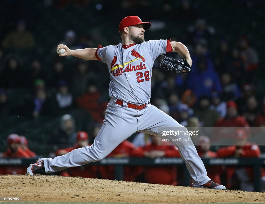 Bud Norris #26 of the St. Louis Cardinals pitches in the 9th inning for a save against the Chicago Cubs at Wrigley Field on April 17, 2018 in Chicago, Illinois. The Cardinals defeated the Cubs 5-3.