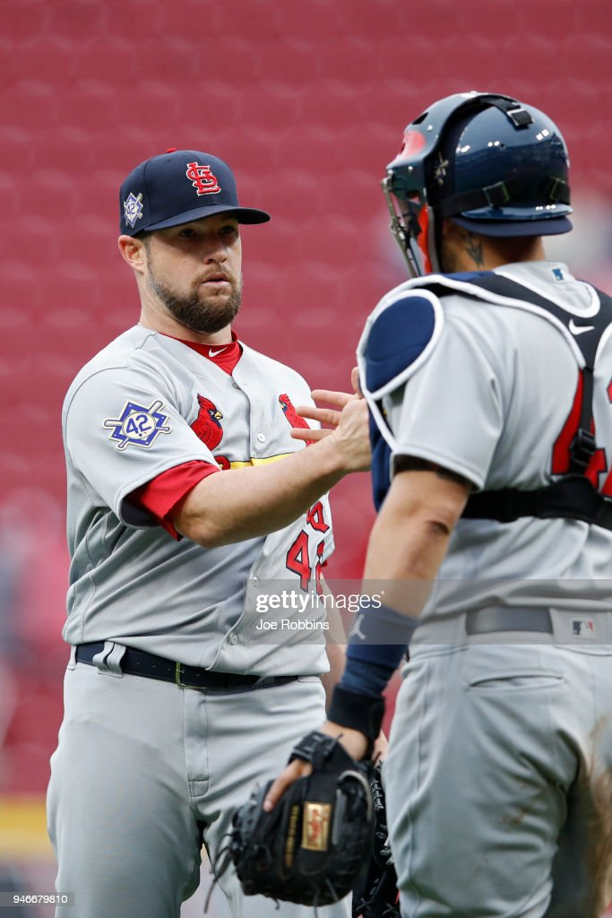 Bud Norris #26 of the St. Louis Cardinals reacts after pitching the final out in the ninth inning of the game against the Cincinnati Reds at Great American Ball Park on April 15, 2018 in Cincinnati, Ohio. The Cardinals won 3-2. All players are wearing #42 in honor of Jackie Robinson Day.