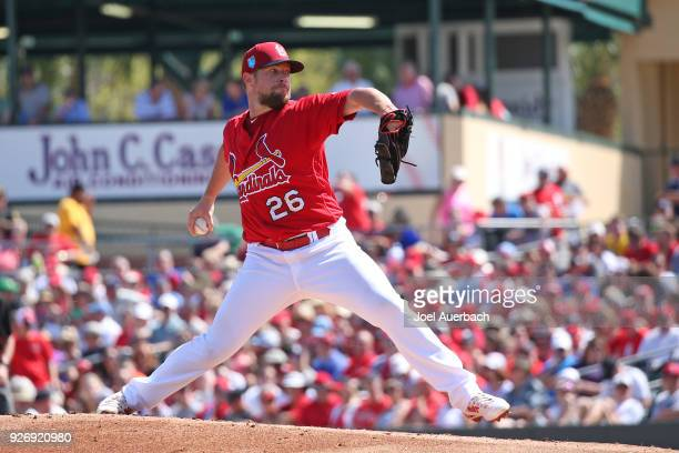 Bud Norris of the St Louis Cardinals throws the ball against the Boston Red Sox during a spring training game at Roger Dean Chevrolet Stadium on...