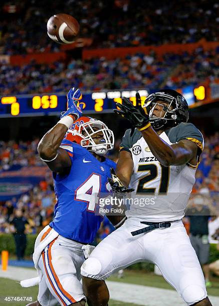 Bud Sasser of the Missouri Tigers catches a pass out of bounds in the endzone past the defense of Keanu Neal of the Florida Gators in during the...