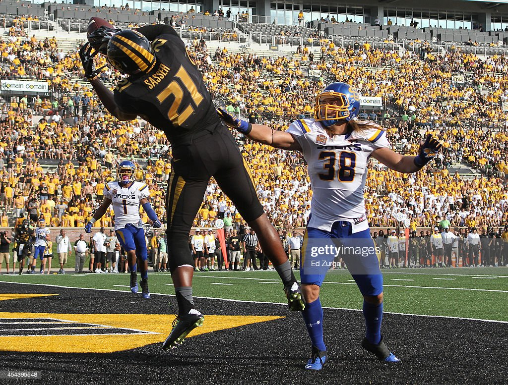 Bud Sasser #21 of the Missouri Tigers catches a touchdown pass against defensive back Jake Gentile #38 of the South Dakota State Jackrabbits in the fourth quarter at Memorial Stadium on August 30, 2014 in Columbia, Missouri.
