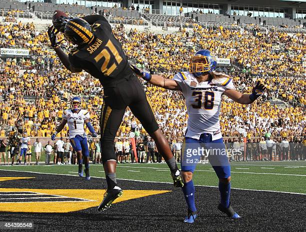 Bud Sasser of the Missouri Tigers catches a touchdown pass against defensive back Jake Gentile of the South Dakota State Jackrabbits in the fourth...