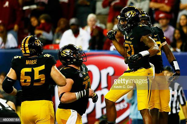Bud Sasser of the Missouri Tigers celebrates with teammates after scoring a touchdown against the Alabama Crimson Tide in the third quarter of the...