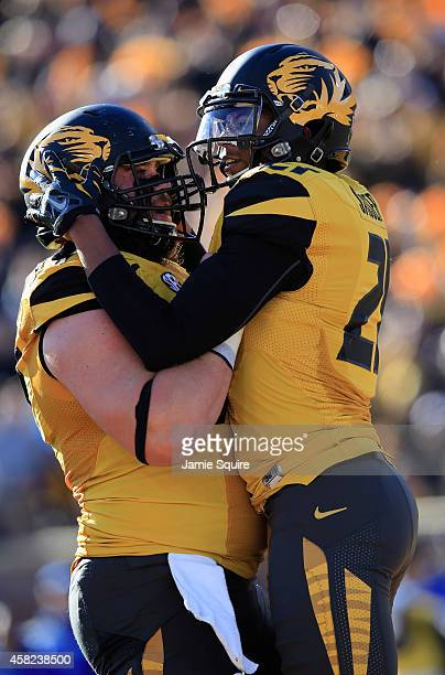 Bud Sasser of the Missouri Tigers is congratulated by Evan Boehm of the Missouri Tigers after scoring a touchdown during the first half of the game...