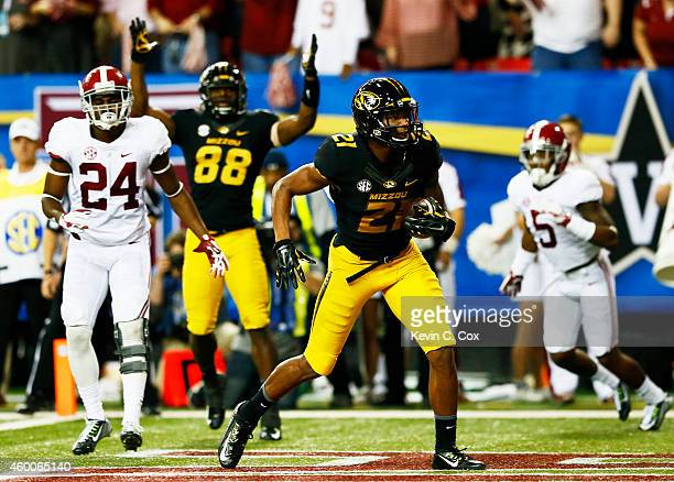 Bud Sasser of the Missouri Tigers scores a touchdown against the Alabama Crimson Tide in the third quarter of the SEC Championship game at the...