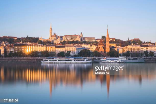 buda castle hill and urban skyline along danube river with reflection at dawn, budapest, hungary - royal palace budapest stock pictures, royalty-free photos & images