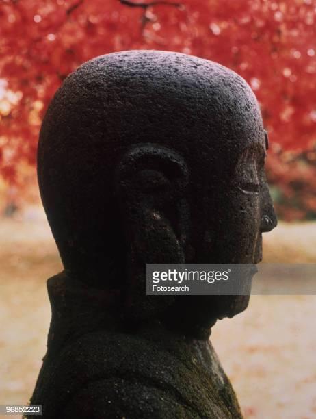 Buda statue in garden circa 1960s