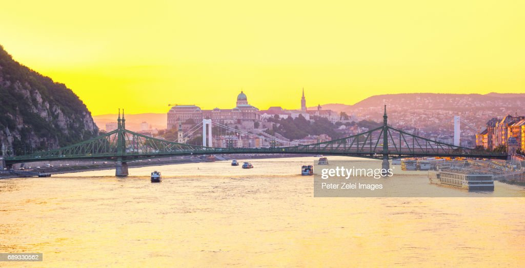 Budapest cityscape at sunset with the Liberty and Elizabeth bridges, and the Buda Castle in the background : Stock Photo