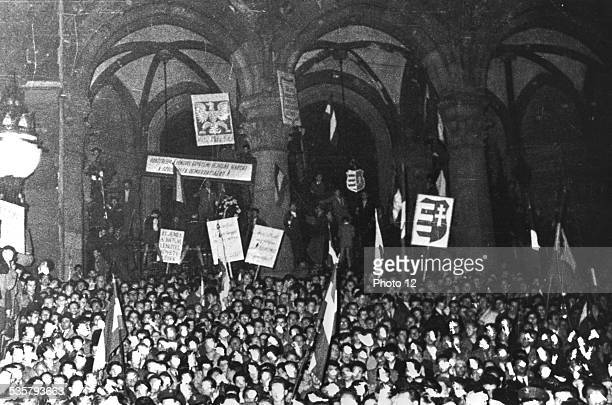 1956 Budapest demonstration in front of the Parliament during the night of October 23 The hammer and sickle are not to be seen anymore but the...