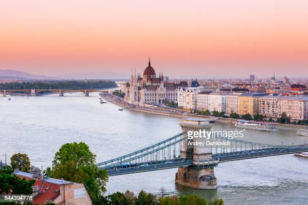 budapest, hungarian parliament in sunset - budapest stock pictures, royalty-free photos & images